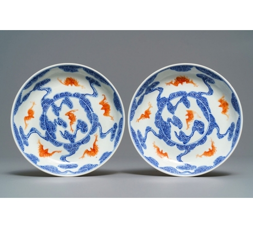Rob Michiels AuctionsA pair of Chinese blue, white and iron red 'bats and clouds' plates, Guangxu mark, 19/20th C.