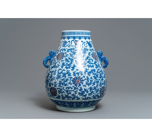 Rob Michiels AuctionsA Chinese blue, white and copper red 'hu' vase, Qianlong mark, 19/20th C.