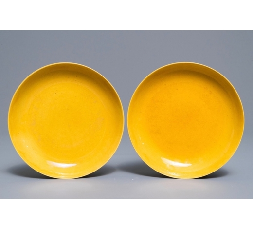 Rob Michiels AuctionsA pair of imperial Chinese monochrome yellow plates, Tongzhi mark and of the period