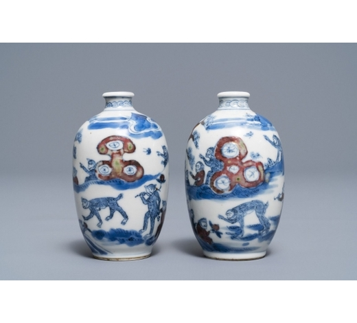 Rob Michiels AuctionsA pair of Chinese blue, white and underglaze red '16 monkeys' snuff bottles, Yongzheng mark, 19th C.