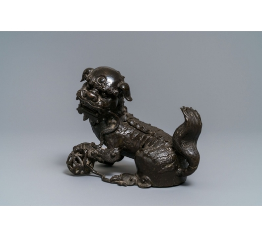Rob Michiels AuctionsA Chinese bronze model of a Buddhist lion, Ming