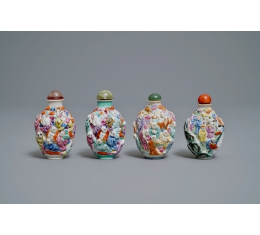Rob Michiels AuctionsFour Chinese famille rose porcelain relief-decorated snuff bottles, 19th C.