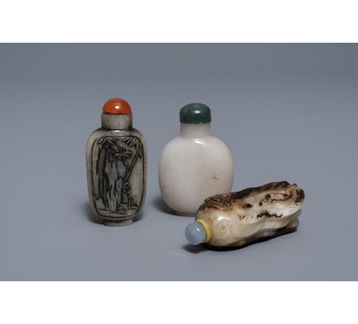 Rob Michiels AuctionsThree Chinese greyish white and black and white jade snuff bottles, 19/20th C.