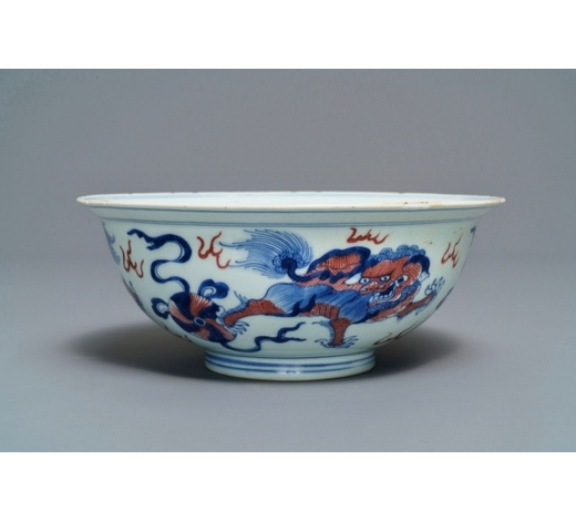 Rob Michiels AuctionsA Chinese blue, white and underglaze red 'Buddhist lion' bowl, Qianlong mark and of the period