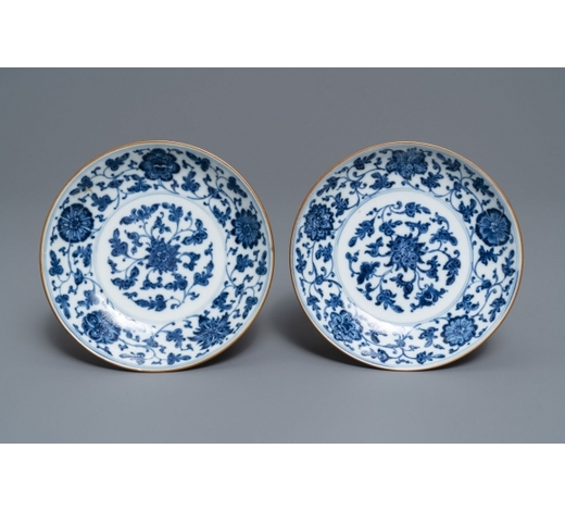 Rob Michiels AuctionsA pair of Chinese blue and white 'flower scroll' plates, Qianlong mark and of the period