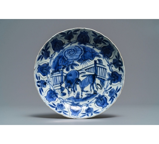 Rob Michiels AuctionsA Chinese blue and white moulded 'two horses' kraak plate, Wanli