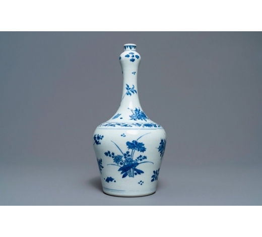 Rob Michiels AuctionsA Chinese blue and white bottle vase with floral design, Transitional period