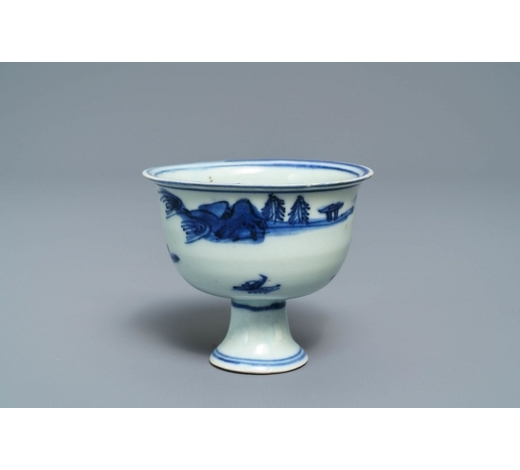 Rob Michiels AuctionsA Chinese blue and white stem cup with landscape design, Transitional period