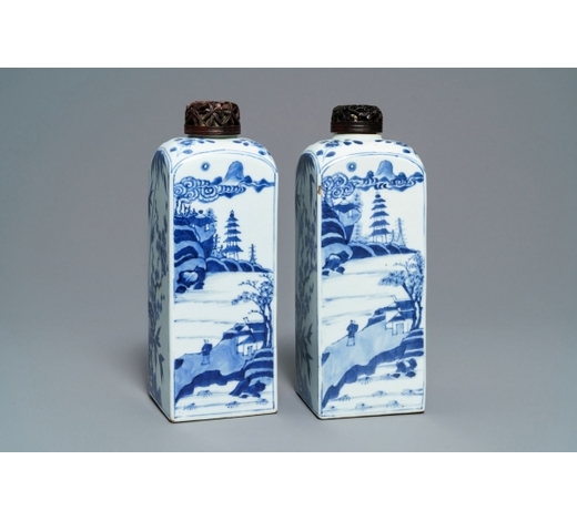 Rob Michiels AuctionsA pair of Chinese blue and white square tea caddies with landscapes and flowers, Kangxi