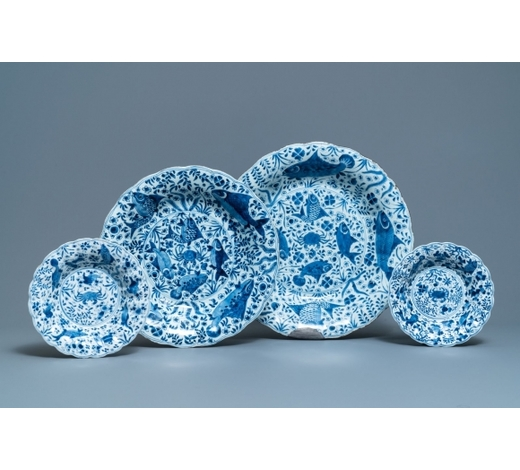 Rob Michiels AuctionsTwo Chinese blue and white gadrooned 'crabs and carps' dishes and a pair of plates, Kangxi