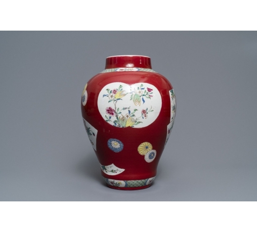 Rob Michiels AuctionsA fine Chinese famille rose ruby ground baluster vase with floral panels, Yongzheng