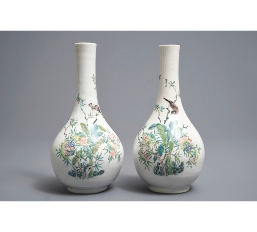 Rob Michiels AuctionsA pair of Chinese famille rose bottle vases with birds and flowers, Yongzheng