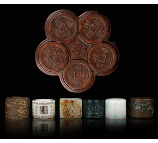 Madison Square Gallery Inc.CHINESE CARVED ARCHERS RINGS IN ARGARWOOD BOX
