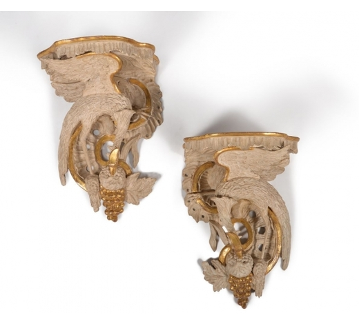 DreweattsA pair of carved wood, painted and parcel gilt wall brackets, in George III style, 19th century and
