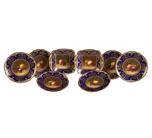 DreweattsA Coalport blue-ground and gilt part dessert service painted with autumnal fallen fruit and signed b